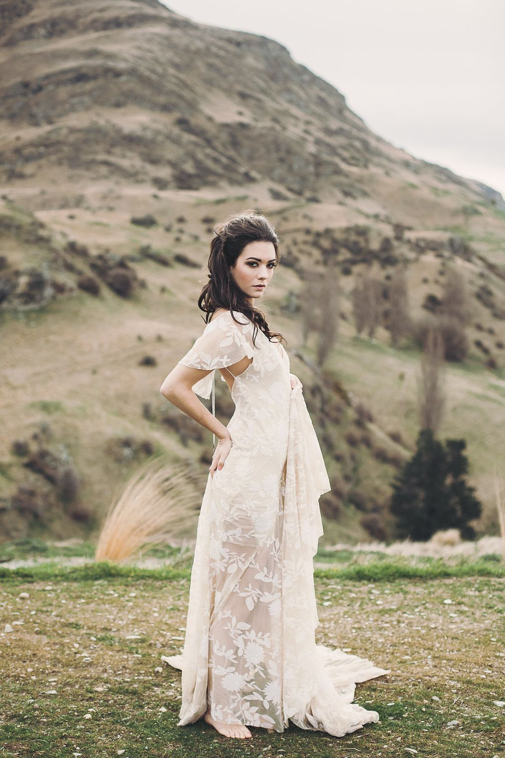 Bride standing on farm in Queenstown